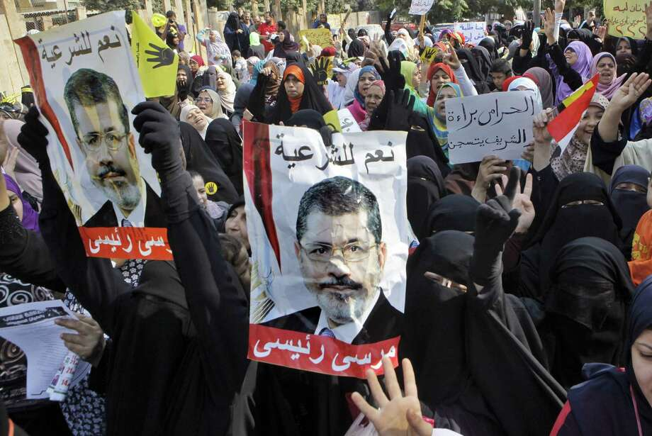 Secretary of State John Kerry's Egypt visit comes at a tense time as ex-President Mohammed Morsi faces murder charges. Photo: Amr Nabil / Associated Press