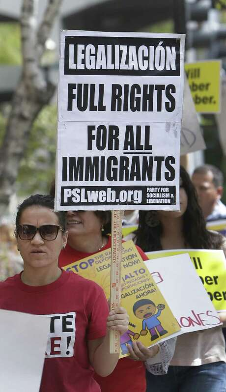 More than two dozen immigrant-rights advocates, students, labor and community activists march Tuesday outside the state Republican Party Headquarters  in Sacramento, Calif. Photo: Rich Pedroncelli / Associated Press
