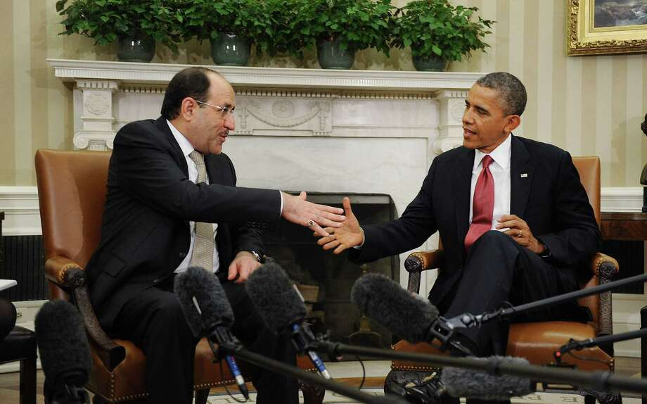 Iraq Prime Minister Nouri Al-Maliki (left) meets with President Barack Obama on Friday in the Oval Office. Al-Maliki was expected to ask for U.S. help to battle sectarian violence.