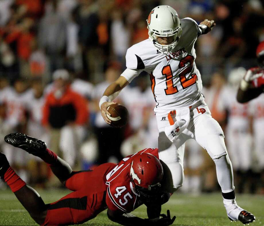 La Porte quarterback Jordan Jackson (12) is sacked by North Shore's Zack Whitley during the first half of a high school football game, Friday, November 1, 2013 at Galena Park ISD Stadium in Houston. Photo: Eric Christian Smith, For The Chronicle