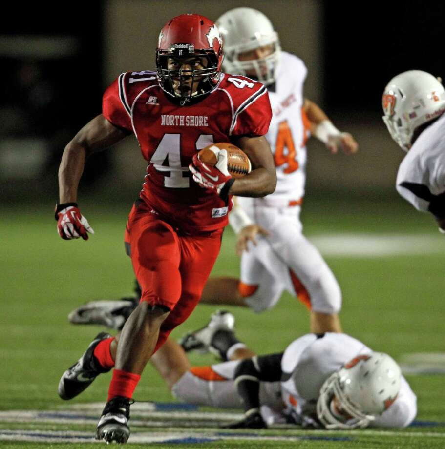 North Shore's Tristian Houston (41) runs the ball upfield during the first half of a high school football game against La Porte, Friday, November 1, 2013 at Galena Park ISD Stadium in Houston. Photo: Eric Christian Smith, For The Chronicle