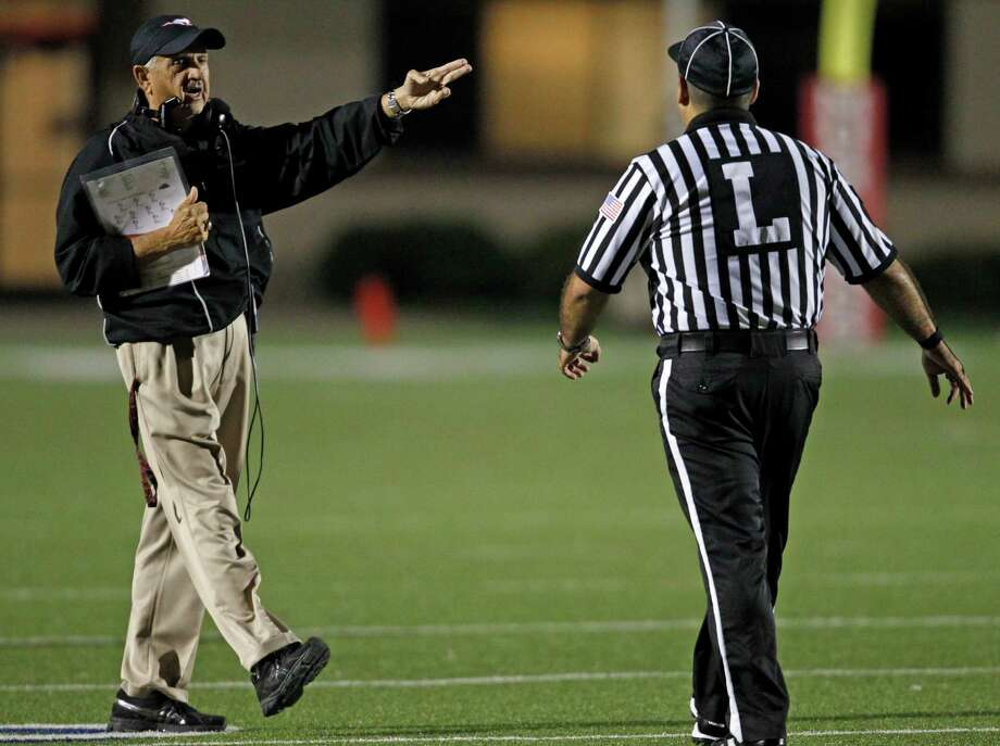 North Shore head coach David Aymond has words with an official during the first half of a high school football game against La Porte, Friday, November 1, 2013 at Galena Park ISD Stadium in Houston. Photo: Eric Christian Smith, For The Chronicle