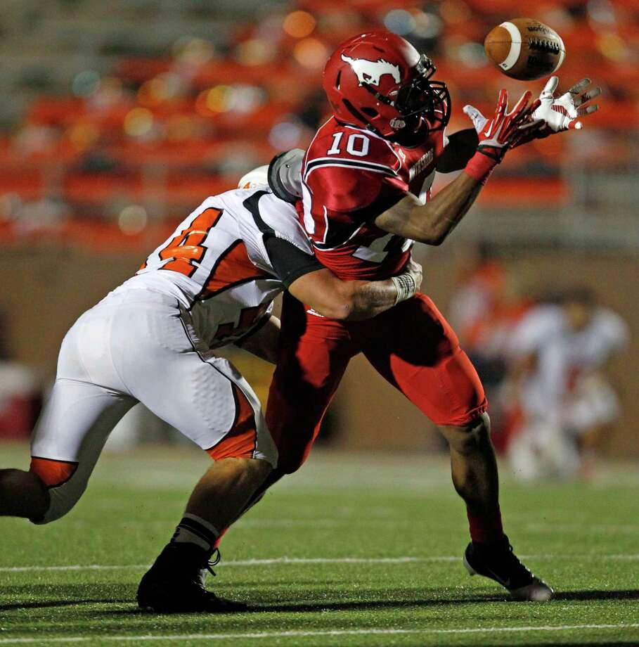 North Shore's Justin Green (10) fumbles the ball after being tackled by La Porte's Toby Detillier during the first half of a high school football game, Friday, November 1, 2013 at Galena Park ISD Stadium in Houston. Photo: Eric Christian Smith, For The Chronicle
