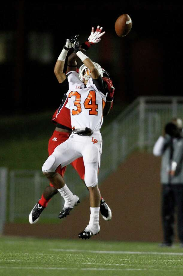North Shore's Anthony Jammer deflects a pass intended or La Porte's David Terrebonne (34) during the first half of a high school football game, Friday, November 1, 2013 at Galena Park ISD Stadium in Houston. Photo: Eric Christian Smith, For The Chronicle