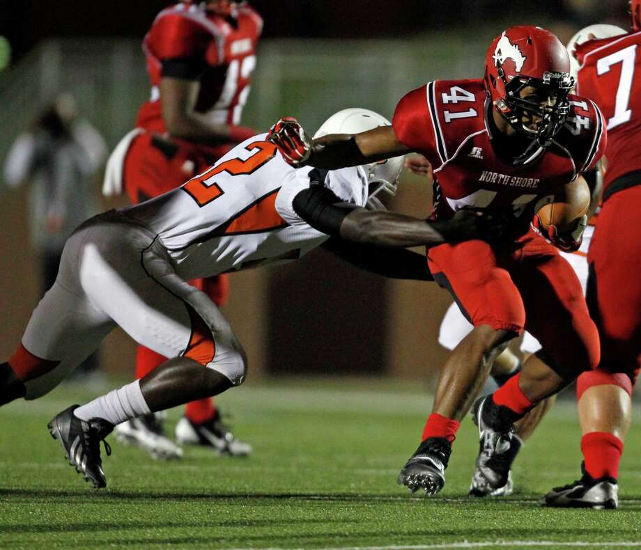 North Shore's Tristian Houston (41) is tackled by La Porte's Jordan Herbert during the first half of a high school football game, Friday, November 1, 2013 at Galena Park ISD Stadium in Houston. Photo: Eric Christian Smith, For The Chronicle