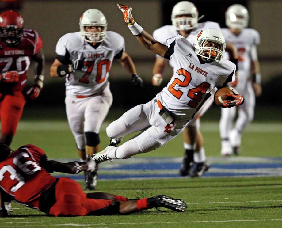 La Porte's Britt Grant (24) is tackled by North Shore's J.T. Matthews during the first half of a high school football game, Friday, November 1, 2013 at Galena Park ISD Stadium in Houston. Photo: Eric Christian Smith, For The Chronicle