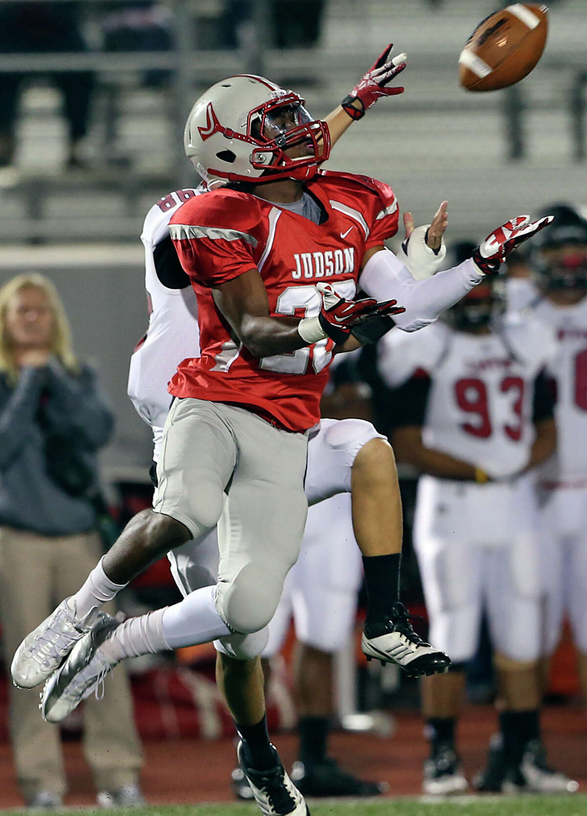 Rocket defensive back D'mauria Martin goes up to pick off a long pass intended for Eric Perez as Judson hosts Canyon at Rutledge Stadium on November 1, 2013.