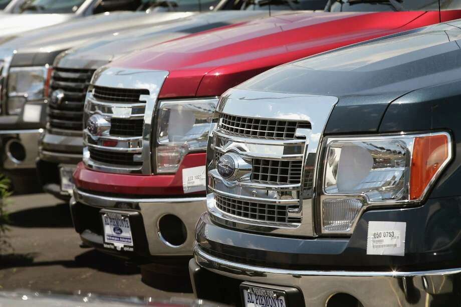 Ford trucks await buyers at a dealership in Melrose Park, Ill. F-Series sales in October were up 13 percent to 63,803, a sixth straight month above 60,000. Photo: Scott Olson, Staff / 2013 Getty Images