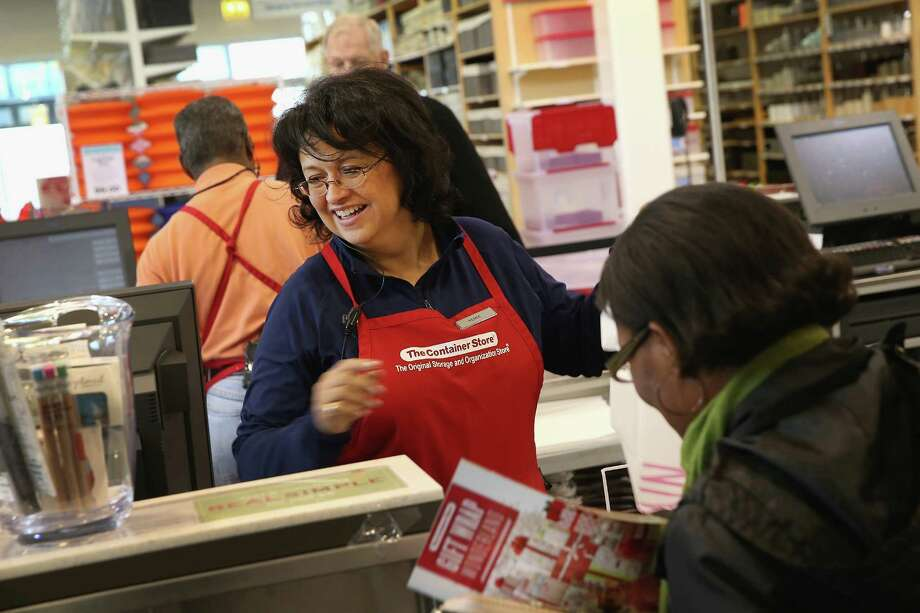 Renee Rios-O'Donnell rings up a customer's merchandise Friday at a Container Store in Chicago. Shares of the retailer's stock began trading on the New York Stock Exchange under the ticker symbol TCS. Photo: Scott Olson, Staff / 2013 Getty Images