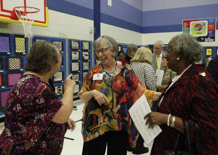 Kay Franklin (center) greets people after the dedication of Kay Franklin Elementary School on Wednesday. Franklin retired in 2008 as Northside's deputy superintendent for administration. Photo: Cynthia Esparza / For The San Antonio Express-News