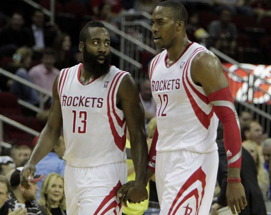 Nov. 1: Rockets 113, Mavericks 105Rockets shooting guard James Harden left, and Rockets center Dwight Howard during a timeout. Photo: James Nielsen, Houston Chronicle