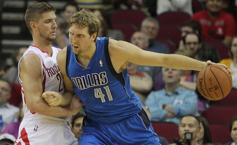 Rockets small forward Chandler Parsons left, plays defense against Mavericks power forward Dirk Nowitzki. Photo: James Nielsen, Houston Chronicle