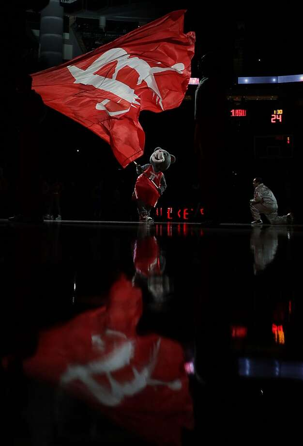 Rockets mascot Clutch waves a Rockets flag before the Rockets face the Mavericks. Photo: James Nielsen, Houston Chronicle
