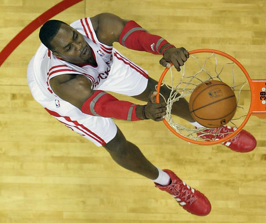 Rockets center Dwight Howard slam dunks the ball against the Mavericks. Photo: James Nielsen, Houston Chronicle