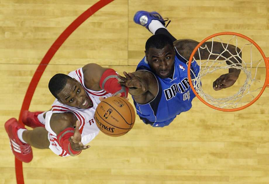 Rockets center Dwight Howard left, and Mavericks center DeJuan Blair right, jump for a rebound. Photo: James Nielsen, Houston Chronicle