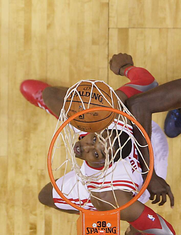 Rockets center Dwight Howard watches his shot fall through the basket against the Mavericks. Photo: James Nielsen, Houston Chronicle