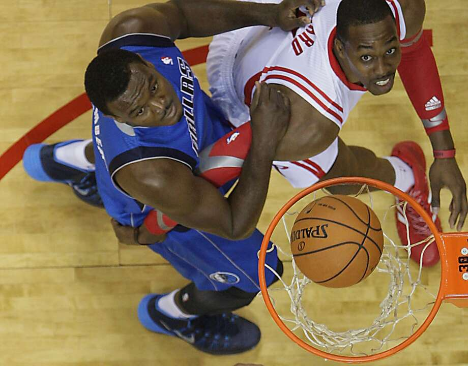 Rockets center Dwight Howard right, watches a Rockets shot fall through the basket as Mavericks center DeJuan Blair left, looks on. Photo: James Nielsen, Houston Chronicle