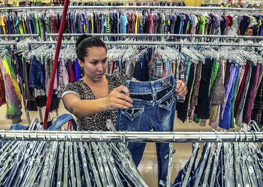 Erica Mendez, 24, a mother of two young children said this was her first trip to a thrift store, October 21, 2013, in Anaheim, California. She usually shops at Ross or Nordstrom Rack but was amazed at the low prices of used clotting at Savers thrift store in Anaheim. (Bruce Chambers/Orange County Register) Photo: BRUCE CHAMBERS / Orange County Register