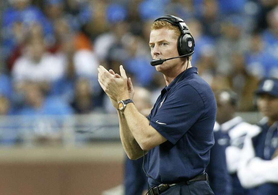 "Jason Garrett's Cowboys are just 4-4, but that's good enough to hold first place in the NFC East. ""I wish everyone could see how hard he works,"" owner Jerry Jones told Dallas' KRLD-FM. Photo: Duane Burleson / Associated Press"
