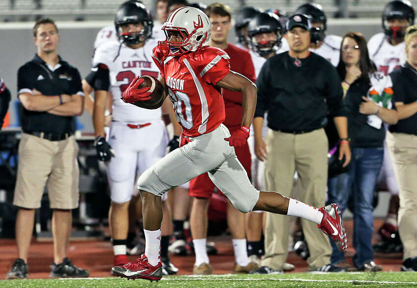 Rocket receiver Michael Akai sprints down the sideline in front of the Cougar bench for his second touchdown as Judson hosts Canyon at Rutledge Stadium on November 1, 2013.