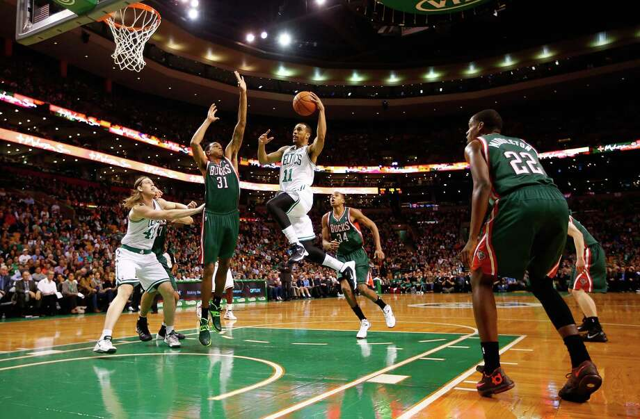BOSTON, MA - NOVEMBER 01: Courtney Lee #11 of the Boston Celtics drives to the basket in front of John Henson #31 of the Milwaukee Bucks in the first quarter during the home opener at TD Garden on November 1, 2013 in Boston, Massachusetts. NOTE TO USER: User expressly acknowledges and agrees that, by downloading and or using this photograph, User is consenting to the terms and conditions of the Getty Images License Agreement. (Photo by Jared Wickerham/Getty Images) ORG XMIT: 182407359 Photo: Jared Wickerham / 2013 Getty Images