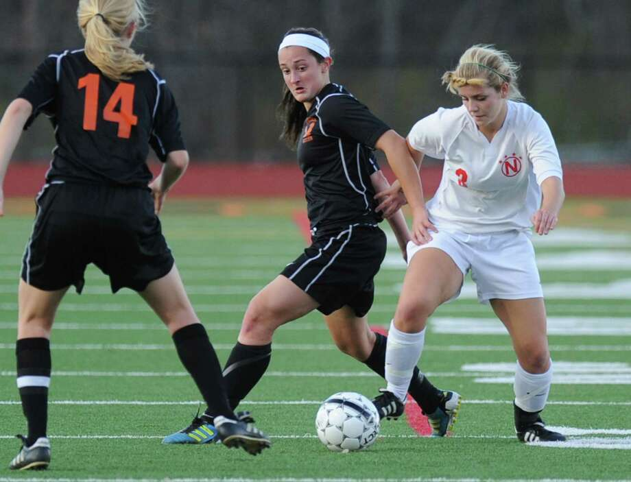 From left, Bethlehem's Samantha Taillon and Kaylee Rickert try to get the ball away from Niskayuna'a Maddie Karafanda during  a Section II girls' soccer semifinal against  Bethlehem on Friday, Nov. 1, 2013 in Schuylerville, N.Y.  (Lori Van Buren / Times Union) Photo: Lori Van Buren / 00024466A