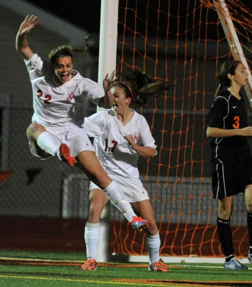Niskayuna'a Kelly Hartlage celebrates Rachel Walsh's, middle, goal in overtime during a Section II girls' soccer semifinal against  Bethlehem on Friday, Nov. 1, 2013 in Schuylerville, N.Y.  (Lori Van Buren / Times Union) Photo: Lori Van Buren / 00024466A