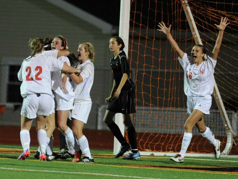 Niskayuna celebrates Rachel Walsh's goal in overtime during a Section II girls' soccer semifinal against  Bethlehem on Friday, Nov. 1, 2013 in Schuylerville, N.Y.  (Lori Van Buren / Times Union) Photo: Lori Van Buren / 00024466A