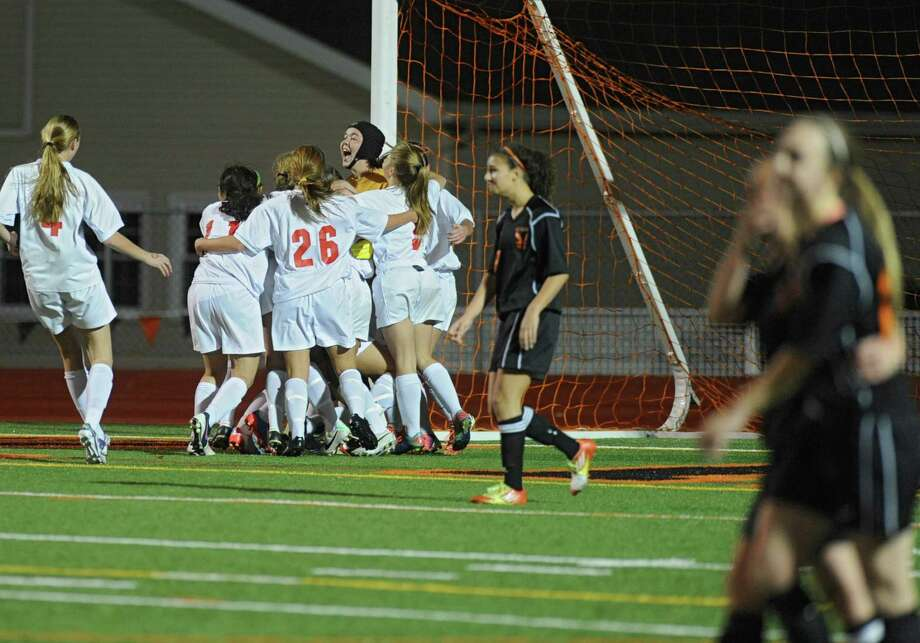 Niskayuna celebrates their win in overtime during a Section II girls' soccer semifinal against  Bethlehem on Friday, Nov. 1, 2013 in Schuylerville, N.Y.  (Lori Van Buren / Times Union) Photo: Lori Van Buren / 00024466A