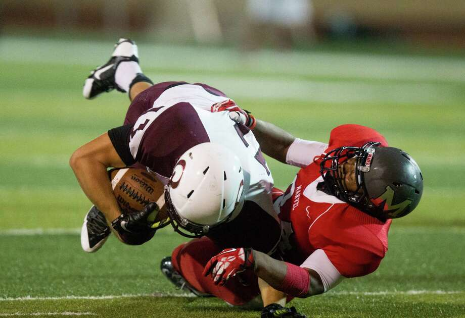 Pearland running back Zachary Boegler, left, is brought down by Manvel linebacker Keshon King during the second half of a high school football game at Alvin Memorial Stadium on Friday, Nov. 1, 2013, in Alvin Photo: J. Patric Schneider, For The Chronicle / © 2013 Houston Chronicle
