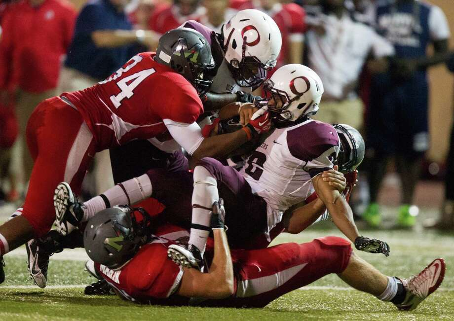 Pearland running back JaColbie Butler is brought down by a swarm of Manvel defenders during the second half of a high school football game at Alvin Memorial Stadium on Friday, Nov. 1, 2013, in Alvin Photo: J. Patric Schneider, For The Chronicle / © 2013 Houston Chronicle