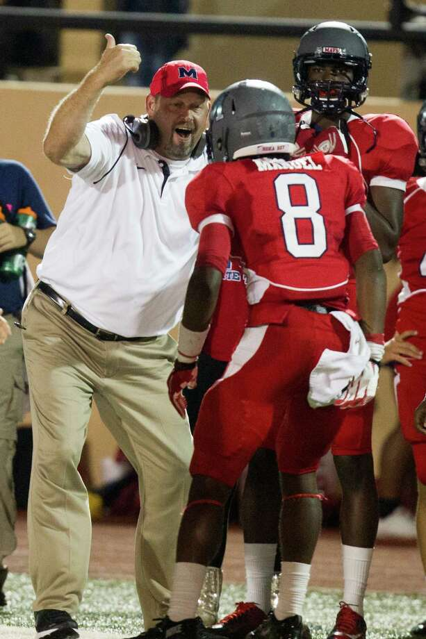 Manvel head coach Kirk Martin celebrates with wide receiver Jamond Manuel (8) after Manuel scored a touchdown during the second half of a high school football game against Pearland at Alvin Memorial Stadium on Friday, Nov. 1, 2013, in Alvin Photo: J. Patric Schneider, For The Chronicle / © 2013 Houston Chronicle