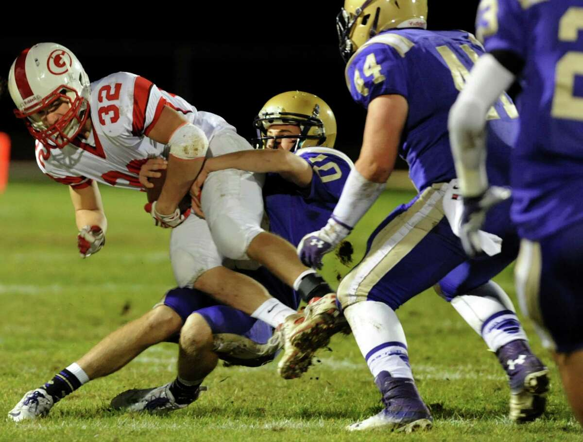 Guilderland's Bradley Johnston, left, can't fight off a tackle from CBA's Donald Vivian during their Class AA semifinal football game against Guilderland on Friday, Nov. 1, 2013, at Christian Brothers Academy in Colonie, N.Y. (Cindy Schultz / Times Union)
