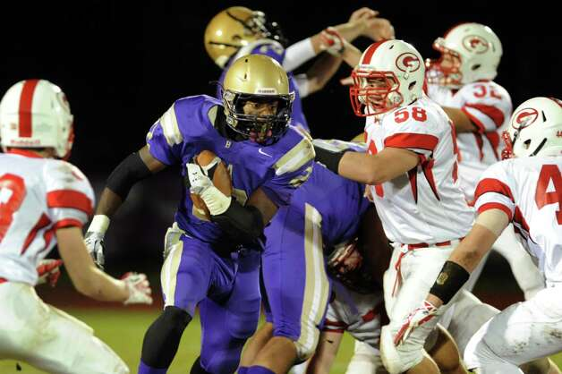 CBA's Elliot Croskey, center, gains yards during their Class AA semifinal football game against Guilderland on Friday, Nov. 1, 2013, at Christian Brothers Academy in Colonie, N.Y. (Cindy Schultz / Times Union) Photo: Cindy Schultz / 00024470A