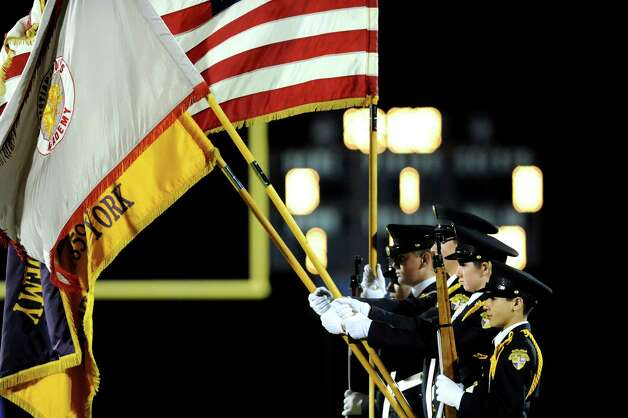 CBA's color guard stands at attention for the National Anthem during their Class AA semifinal football game against Guilderland on Friday, Nov. 1, 2013, at Christian Brothers Academy in Colonie, N.Y. (Cindy Schultz / Times Union) Photo: Cindy Schultz / 00024470A
