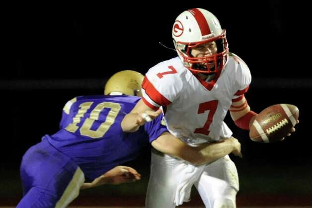 Guilderland's quarterback Frank Gallo, right, tries to fend off a sack from CBA's Donald Vivian during their Class AA semifinal football game against Guilderland on Friday, Nov. 1, 2013, at Christian Brothers Academy in Colonie, N.Y. (Cindy Schultz / Times Union) Photo: Cindy Schultz / 00024470A