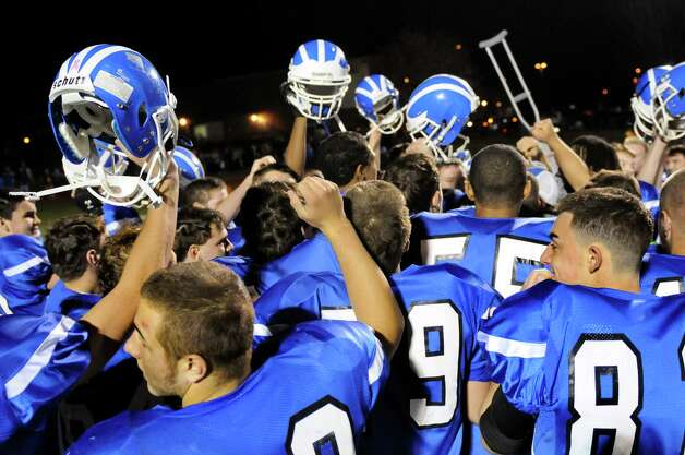 Shaker celebrates their 35-0 win over Saratoga in the Class AA semifinal football game on Friday, Nov. 1, 2013, at Shaker High in Latham, N.Y. (Cindy Schultz / Times Union) Photo: Cindy Schultz / 00024468A
