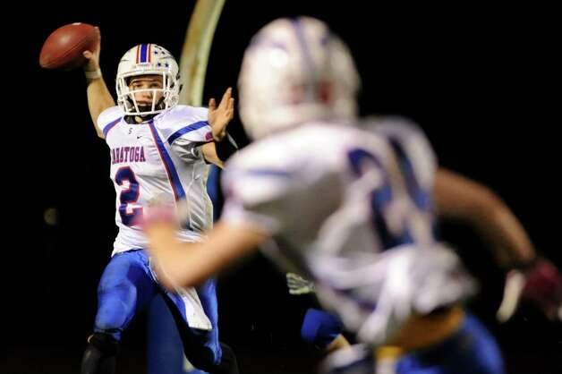Saratoga's quarterback Jack Eglintine, left, gets ready to pass during their Class AA semifinal football game against Shaker on Friday, Nov. 1, 2013, at Shaker High in Latham, N.Y. (Cindy Schultz / Times Union) Photo: Cindy Schultz / 00024468A