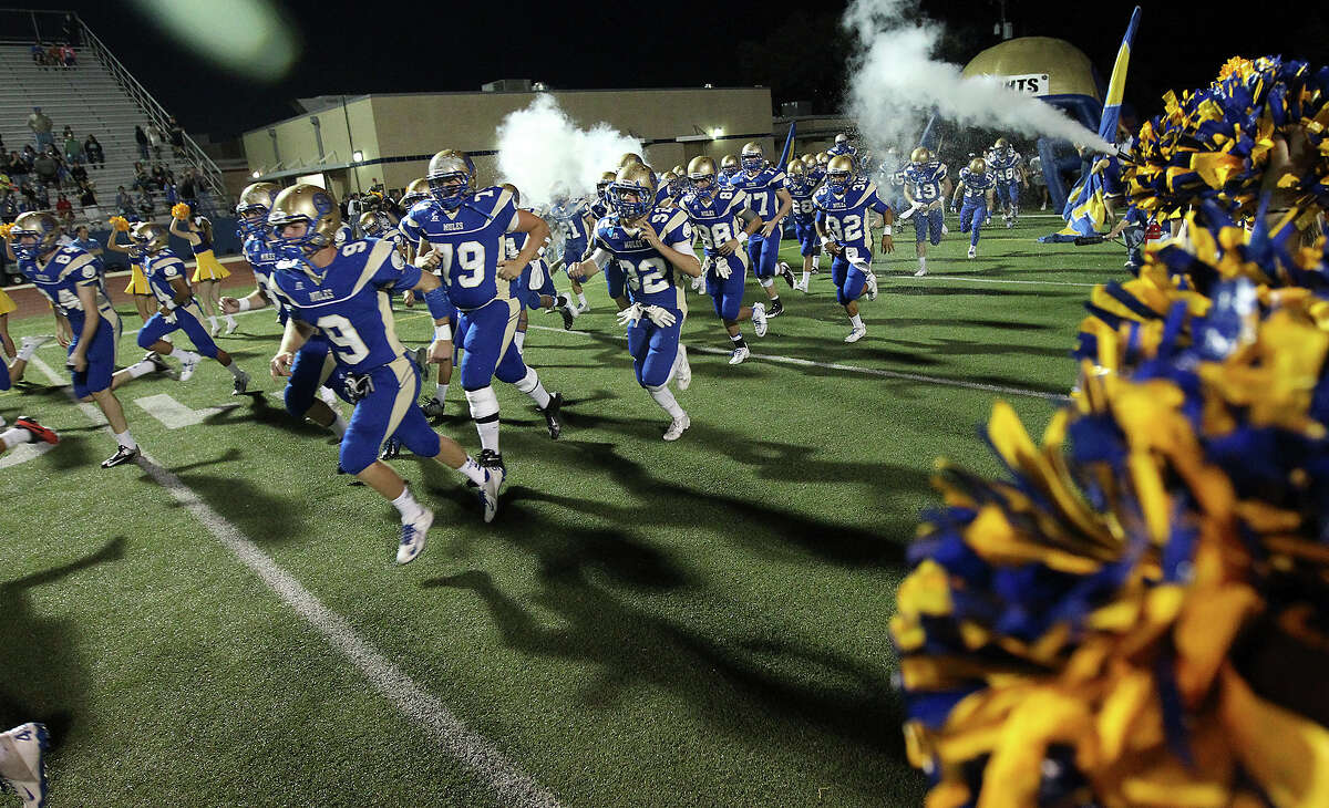 The Alamo Heights Mules take the field for their game against Clemens at Orem Stadium on Friday, Nov. 1, 2013.
