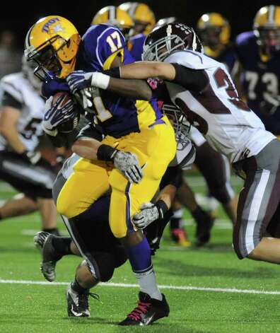 Burnt Hills' Matt Sterlina and David Newell tackle Troy's Kiel Suggs during the Class A semifinal football game on Friday, Nov. 1, 2013 in Troy, N.Y.  (Lori Van Buren / Times Union) Photo: Lori Van Buren / 00024469A