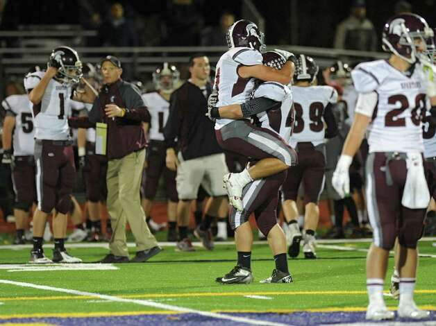 Burnt Hills players begin to celebrate their win after they intercepted the ball with just seconds left in the Class A semifinal football game against Troy on Friday, Nov. 1, 2013 in Troy, N.Y.  (Lori Van Buren / Times Union) Photo: Lori Van Buren / 00024469A