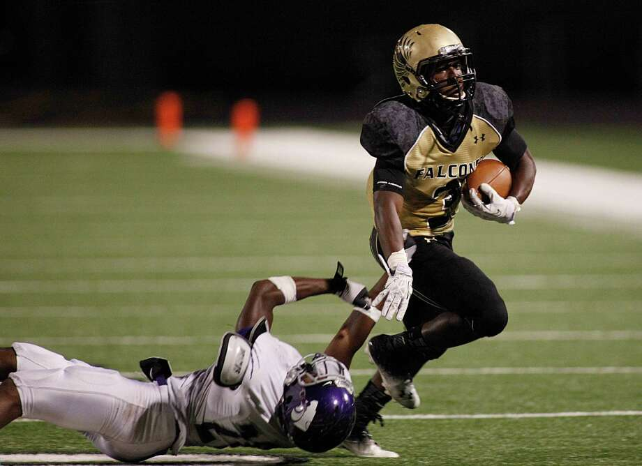 Angelton Wildcats runningback  Marquese Green (3) escapes the tackle from Foster Falcons safety Darius Mucker (28) during the fourth quarter of the high school football game between the Foster Falcons and the Angelton Wildcats at Traylor Stadium on Friday, Nov. 1, 2013, in Rosenberg. Photo: Andrew Richardson, For The Chronicle / © 2013 Andrew Richardson