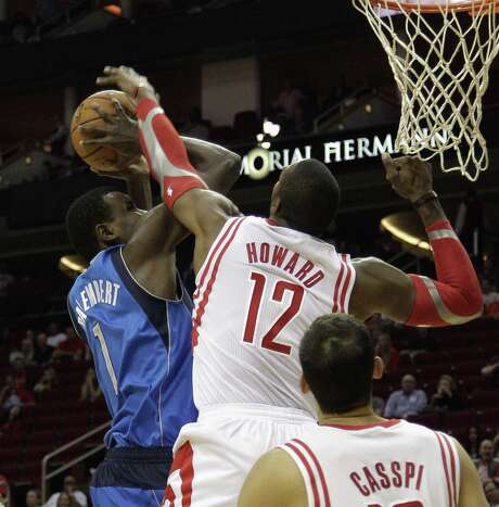 The Rockets' Dwight Howard blocks a shot attempt by the Mavericks' Samuel Dalembert in Houston. Photo: Bob Levey / Getty Images