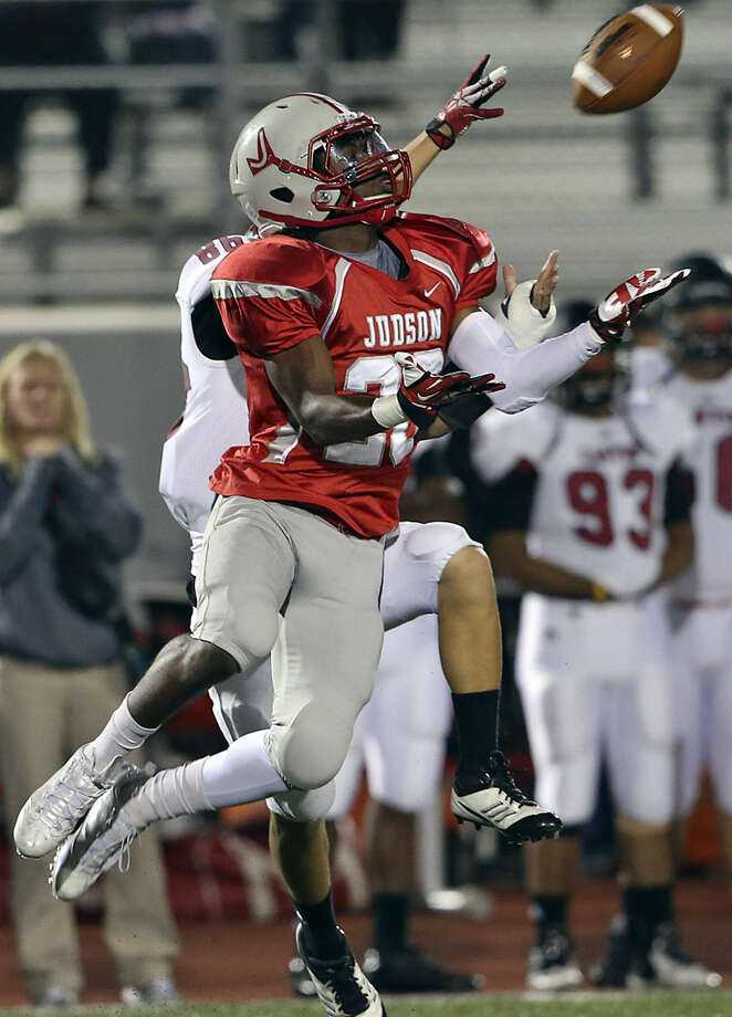 Judson defensive back D'mauria Martin goes up to intercept a long pass intended for New Braunfels Canyon's Eric Perez. Photo: Tom Reel / San Antonio Express-News