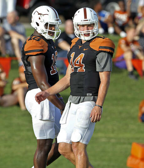 David Ash (right) has been injured most of the season, forcing freshman Tyrone Swoopes into action. Photo: Tom Reel / San Antonio Express-News