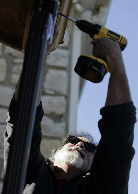 """Monte Railey, a part-time handyman at an elementary school in Missouri City, Mo., also juggles three other jobs. He's OK with making less money, Railey said. """"There's some enjoyment in doing so many different things."""" Photo: JIM BARCUS, MBR / Kansas City Star"""
