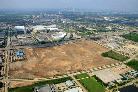 An aerial photo of the old AstroWorld site near Fannin and the South Loop not long after the amusement park's attractions were taken down. A piece of the property, which is near a light-rail station, is for sale.