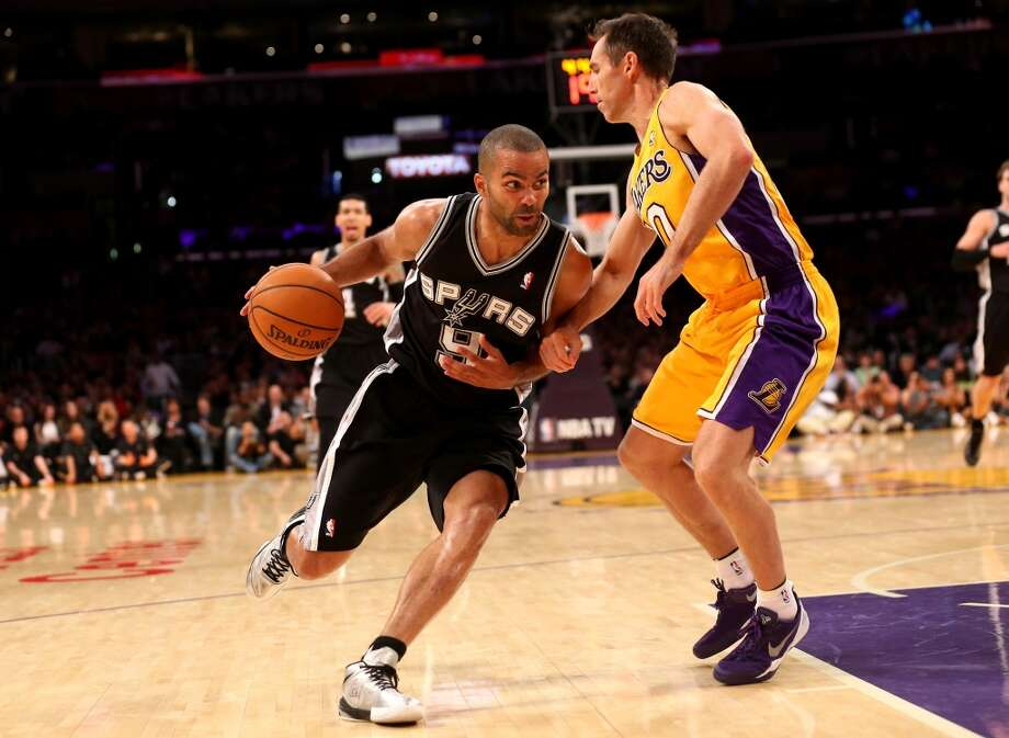 Tony Parker #9 of the San Antonio Spurs drives against Steve Nash #10 of the Los Angeles Lakers at Staples Center on November 1, 2013 in Los Angeles, California. Photo: Stephen Dunn, Getty Images