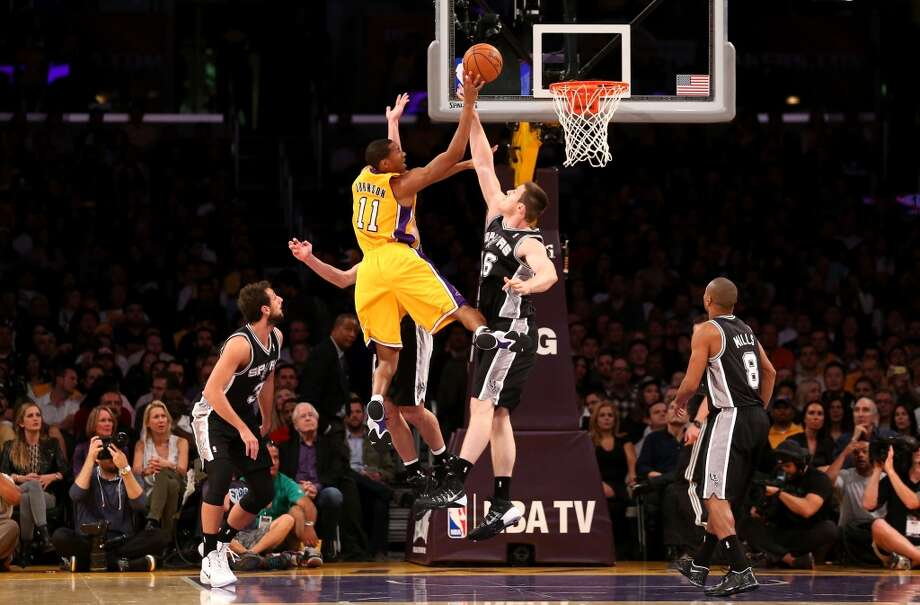 Wesley Johnson #11 of the Los Angeles Lakers shoots over Aron Baynes #16 of the San Antonio Spurs at Staples Center on November 1, 2013 in Los Angeles, California. Photo: Stephen Dunn, Getty Images