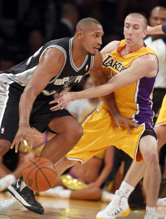 San Antonio Spurs forward Boris Diaw, left, of France, drives with the ball against Los Angeles Lakers guard Steve Blake during the second quarter of an NBA basketball game Friday, Nov. 1, 2013, in Los Angeles. Photo: Alex Gallardo, Associated Press